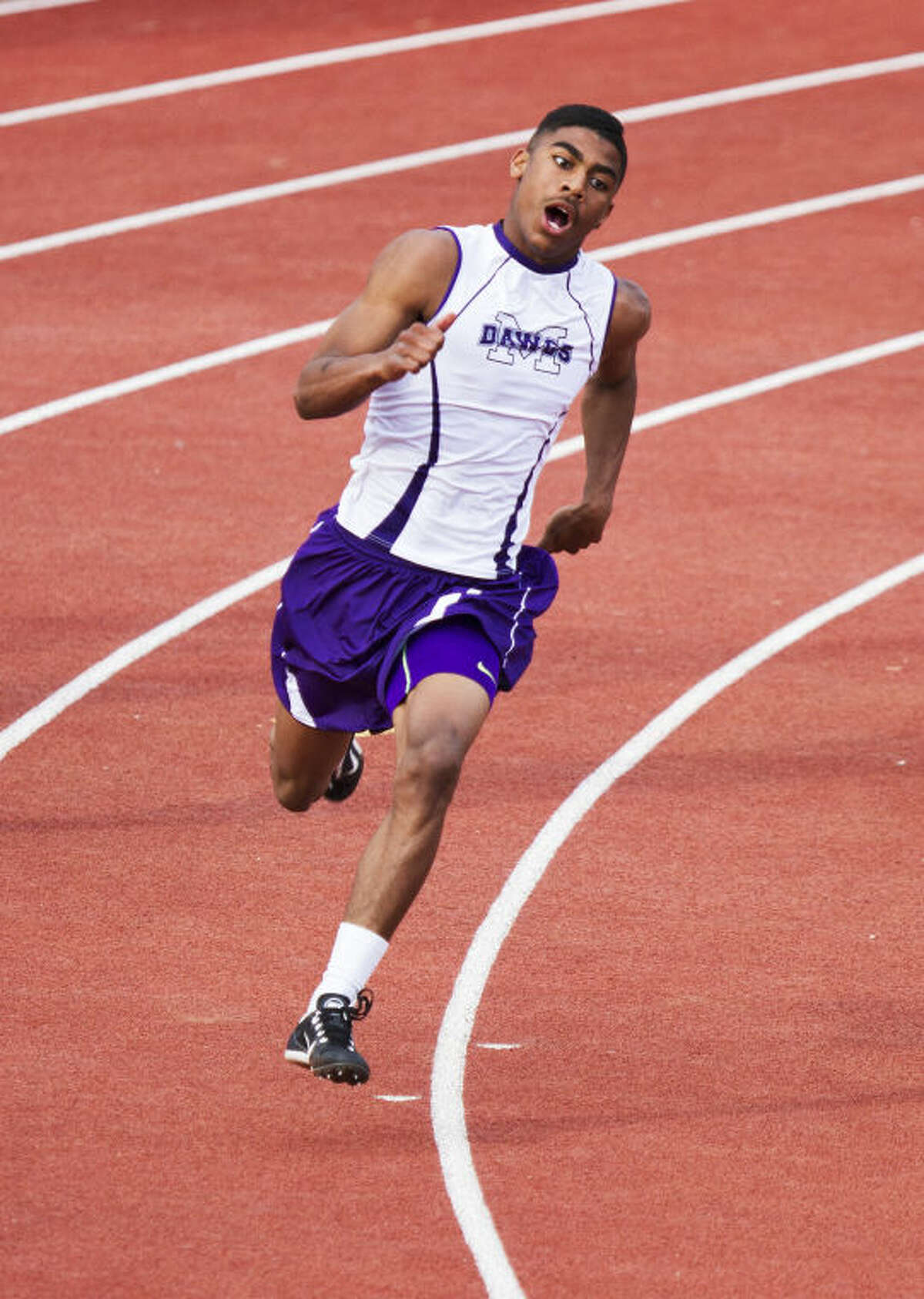 Midland's DeAndre Goodley rounds the corner of the 200M dash during the UIL District 2-5A Track Championship on Friday at Lowrey Field in Lubbock. Goodley won the event with a