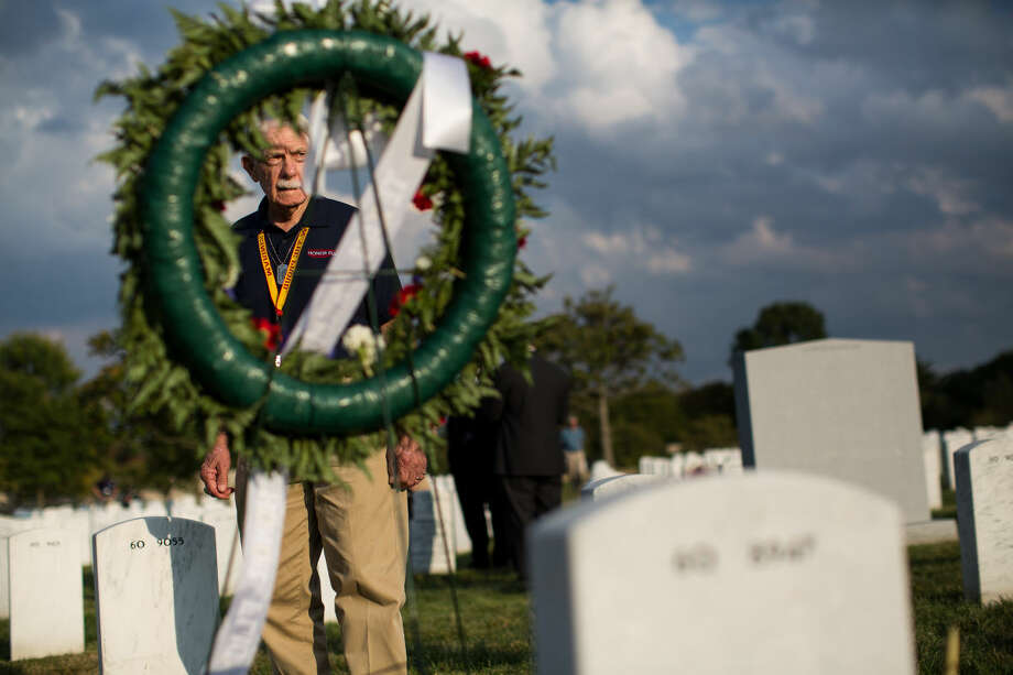 Gene Clardy pays his respects to fallen U.S Army soldier Joshua Mills after a wreath laying ceremony at Arlington National Cemetery last September. Photo: Courtney Sacco