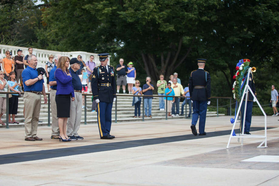 Denise Garza, Jerry Morgan, Odessa Mayor David Turner, and Midland County Judge Mike Bradford from the Texas Permian Basin Honor Flight lay a wreath at the Tomb of the Unknown Soldier at Arlington National Cemetery last September.