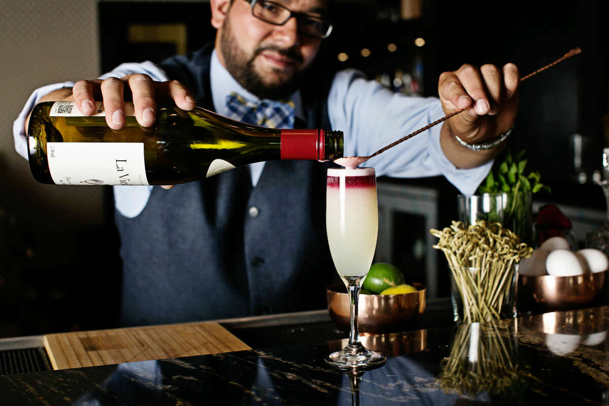 Joe Acosta, general manager of Proof bar near Cork and Pig in Odessa, floats a Mrs. Robinson.