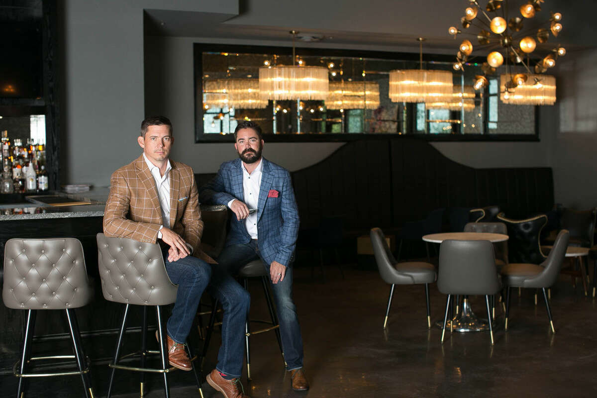 Chris Thompson, left, and Colby Brazile are managing partners of Proof bar.