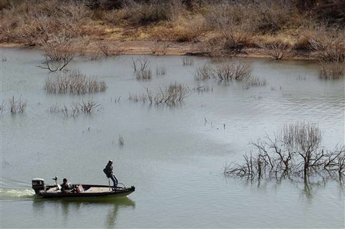 In this April 2014 file photo, fishermen troll for their next catch at Lake Alan Henry in Texas. The lake lost roughly 4 billion gallons of water to evaporation in 2011. An El Nino weather pattern that promises to bring plentiful rain through winter, a National Weather Service forecaster says.