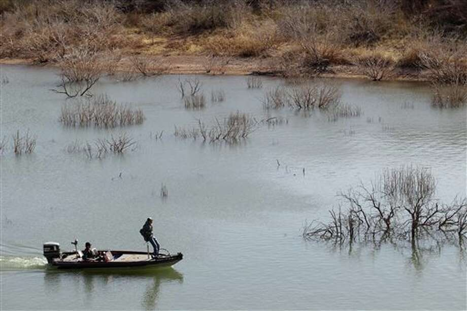 In this April 2014 file photo, fishermen troll for their next catch at Lake Alan Henry in Texas. The lake lost roughly 4 billion gallons of water to evaporation in 2011. An El Nino weather pattern that promises to bring plentiful rain through winter, a National Weather Service forecaster says. Photo: Stephen Spillman / The Avalanche-Journal