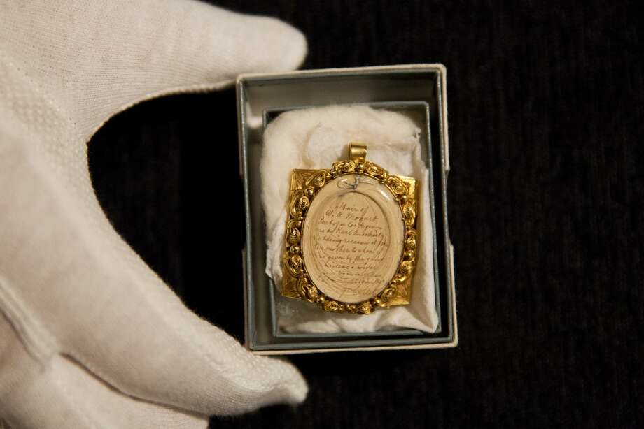 A lock of Wolfgang Amadeus Mozart's hair, contained in a 19th-century gilt locket is among items to be auctioned Thursday by Sotheby in London. It is expected to fetch $15,000 to $18,000. Photo: Matt Dunham/AP
