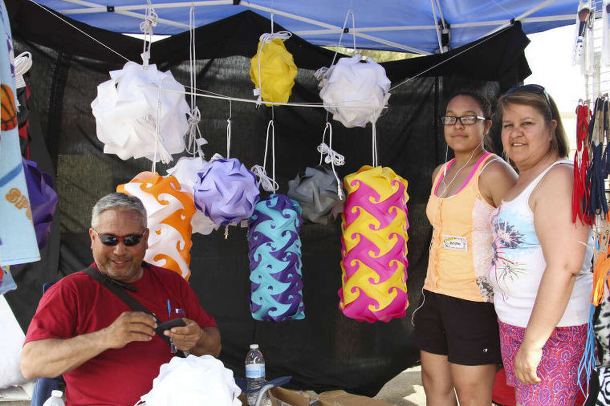 From left: Ron, Melynna and Rosa Morgan started Bankets and More to sell double-stitched blankets and infinity lamps.