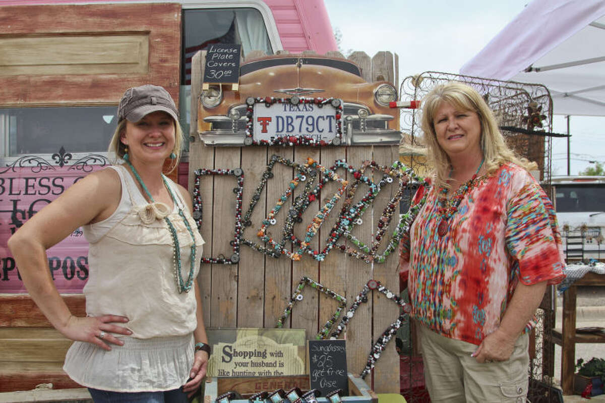 Lacy Jones, left, and her mother, Wendy Roberts, have found success repurposing furniture and decorating other items with vibrant jewel and stone patterns to be sold at various trade shows across the state.