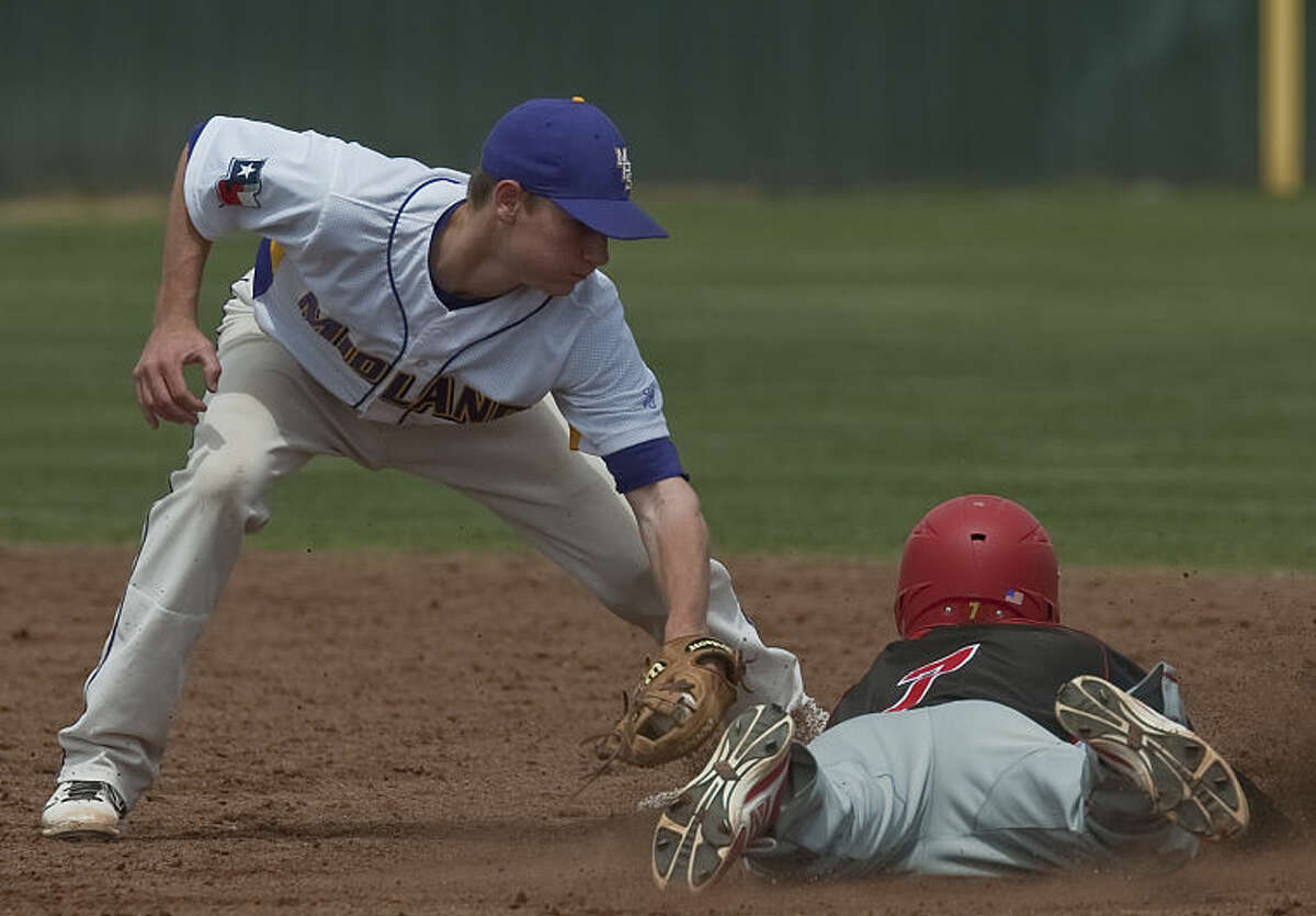 Midland High's Jason Raughton puts the tag on Coronado's Kolt Rogers as he tries to steal second Saturday at Zachery Field. Tim Fischer\Reporter-Telegram