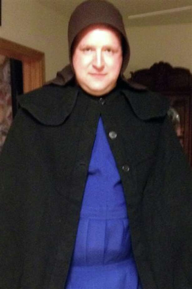 In this undated photo provided by Sgt. Chad Adams of the Pulaski Township Police, Adams is seen dressed as an Amish woman. Adams, a male police officer, spent time on duty in December and January dressed as an Amish woman in hopes of scaring off a man suspected of exposing himself to Amish children in a western Pennsylvania township. The Amish did not want their children to testify in court and agreed to lend police the women's bonnets, aprons and dresses to catch or scare away the suspect. (AP Photo/Courtesy of Chad Adams) Photo: Uncredited / CHAD ADAMS PULASKI TOWNSHIP POLICE