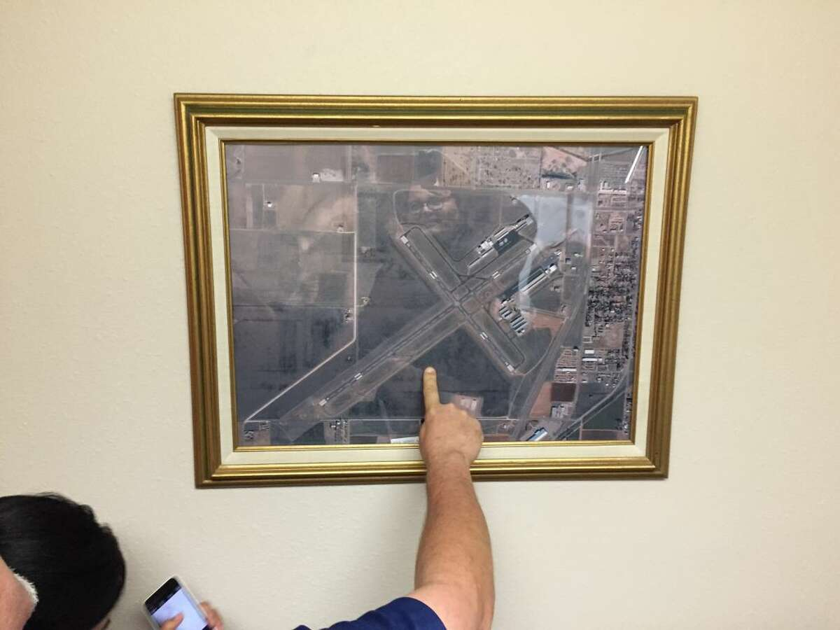 Plainview authorities point out the location of plane wreckage on a map of the Hale County Airport. The plane was found on the southeast side of the runway.