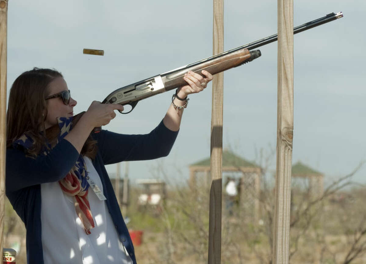 MRT education reporter Tessa Duvall tries her hand at clay pigeon shooting Friday during the Fund For Teachers Clay Shoot at Jake's Clays. Tim Fischer\Reporter-Telegram