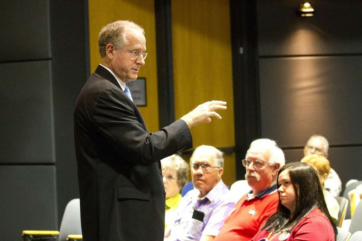 (File Photo) U.S. Rep. Mike Conaway talks to a group of around 30 Permian Basin Residents about health care legislation and other issues Wednesday during a town hall meeting at the Center for Energy and Economic Diversification.
