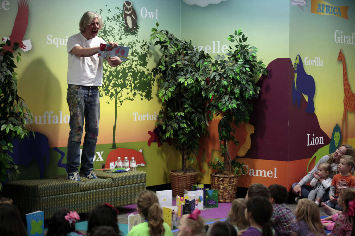 Artist and children's author Herve Tullet reads one of his books to children at the Centennial Library.
