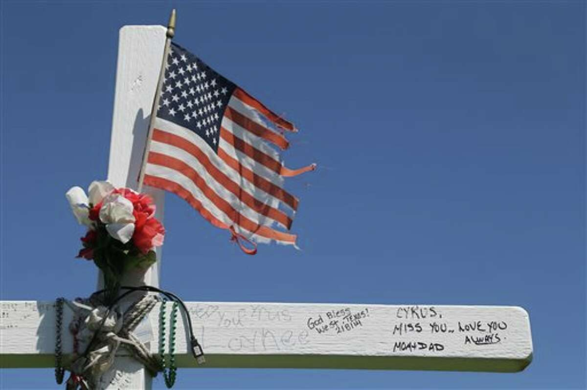 In this April 9, 2014 photo is a wooden cross near the site of the former West, Texas, Fertilizer Company that was destroyed by an explosion one year earlier. On April 18, 2013, a fire at the plant caused a blast that caved in walls at nearby schools and homes, and sent debris flying for miles. (AP Photo/Waco Tribune Herald, Rod Aydelotte)