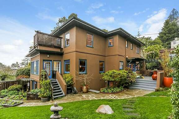 This real estate listings photo shows 670 San Luis Road in the North Berkeley hills. It features four bedrooms and neatly manicured landscaping.