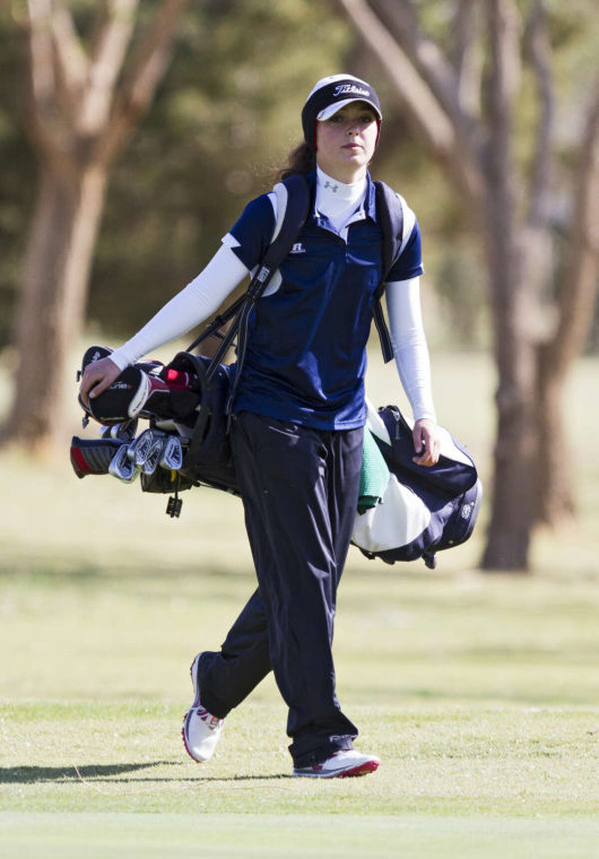 Greenwood's Ryan Pate walks down the fairway during the UIL Girls 3A Regional Golf Tournament on Thursday at Shadow Hills Golf Course in Lubbock. Pate scored a 67 in the final round of the tournament and qualified for the state tournament.