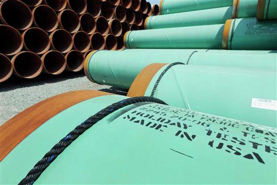 FILE - This May 24, 2012 file photo shows some of about 500 miles worth of coated steel pipe manufactured by Welspun Pipes, Inc., originally for the Keystone oil pipeline, stored in Little Rock, Ark. The US is extending indefinitely the amount of time federal agencies have to review the Keystone XL pipeline, the State Department said Friday, likely punting the decision over the controversial oil pipeline until after the midterm elections. The State Department didn't say how much longer it will grant agencies to weigh in, but cited a recent decision by a Nebraska judge that overturned a state law that allowed the pipeline's path through the state, prompting uncertainty and an ongoing legal battle. Nebraska's Supreme Court isn't expected to rule for another several months and there could be more legal maneuvering after that, potentially freeing President Barack Obama to avoid making a final call on the pipeline until after the election in November. (AP Photo/Danny Johnston, File) Photo: Danny Johnston / AP