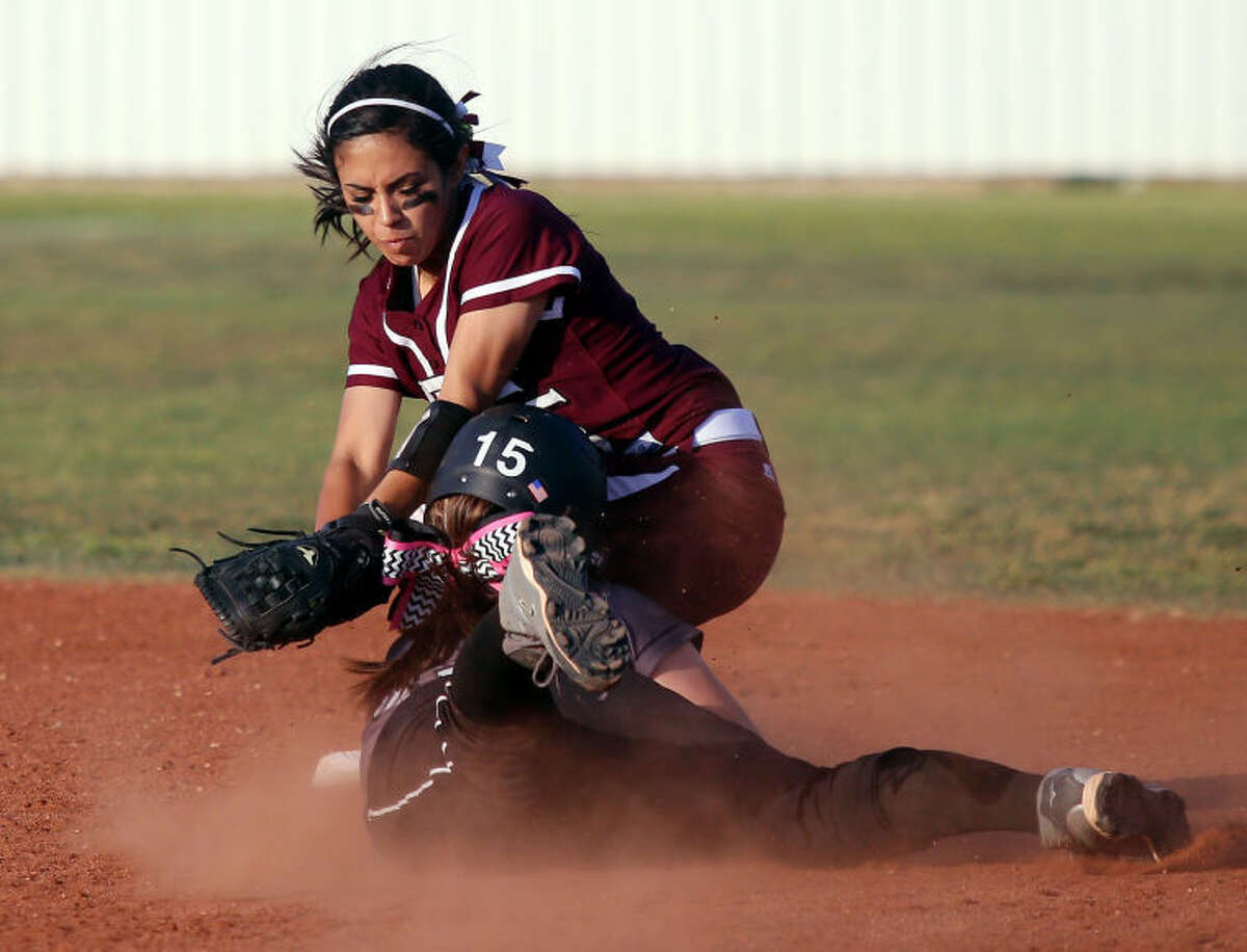 Lee second baseman Gaby Hernandez tags Odessa Permian shortstop Clarissa Martinez out at second base during the 6-1 win Thursday at the Ratliff Softball Complex.