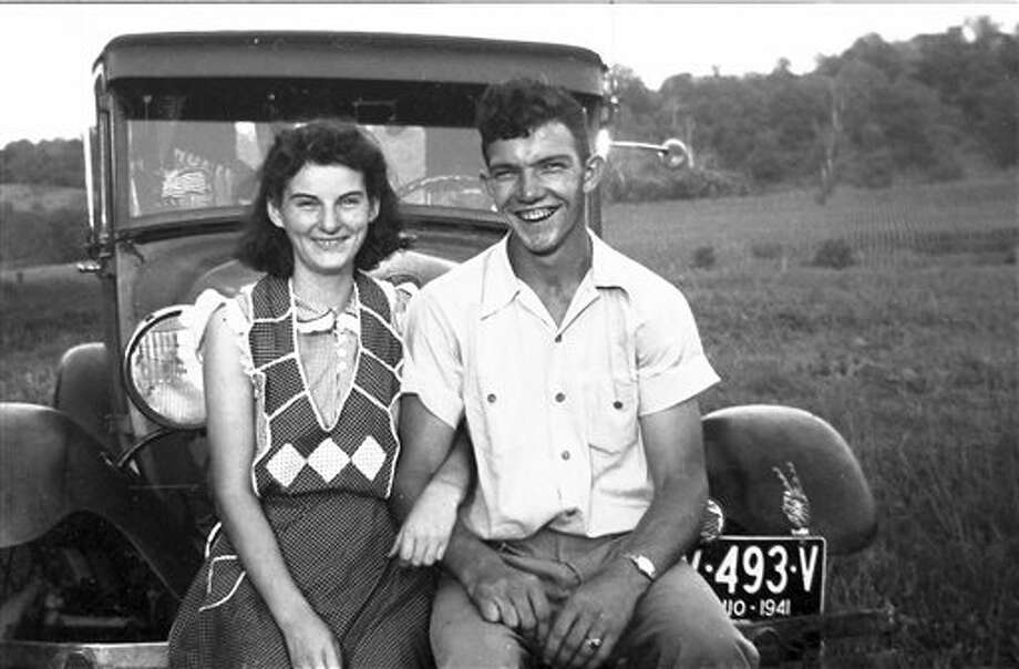 In this September 1941 photo provided by Dick Felumlee, Kenneth and Helen Felumlee pose for a photo nearly three years before their marriage in February 1944. The Felumlees, who celebrated their 70th wedding anniversary in February, died 15 hours apart from each other last week. (AP Photo/Felumlee family) Photo: HONS / Dick Felumlee