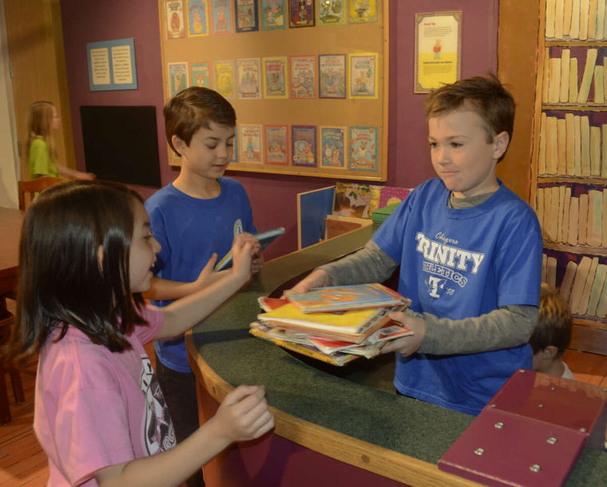 Trinity School second graders play in the library exhibit part of Arthur's exhibit at the Centennial Branch of Midland County Library. Tim Fischer\Reporter-Telegram