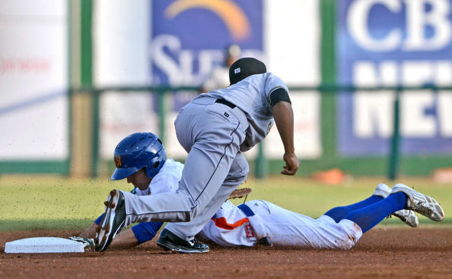 Rockhounds' Billy Burns is tagged out at second base by San Antonio Missions' B.J. Guinn on Thursday at Security Bank Ballpark. James Durbin/Reporter-Telegram Photo: James Durbin