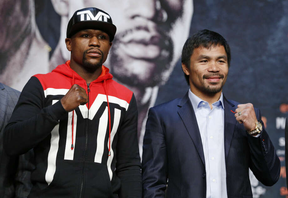 Boxers Floyd Mayweather Jr., left, and Manny Pacquiao pose for photographers during a press conference Wednesday, April 29, 2015, in Las Vegas. The pair are slated to square off Saturday in Las Vegas. (AP Photo/John Locher) Photo: John Locher