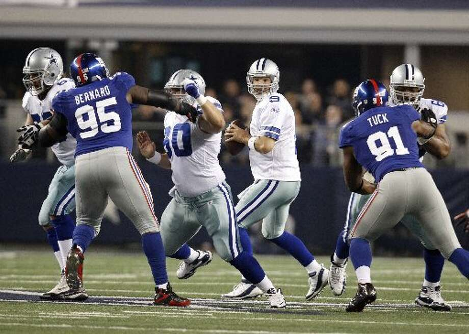 Sharon Ellman/APCowboys quarterback Tony Romo (9) looks to pass on Dec. 11 during the first meeting between the Cowboys and N.Y. Giants  in Arlington. Dallas and the Giants play today to decide who wins the NFC East and goes to the playoffs.