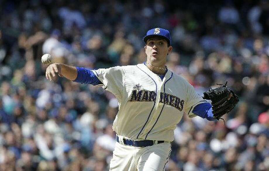 Seattle Mariners relief pitcher and Midland Christian grad Carson Smith in action against the Minnesota Twins in a baseball game Sunday, April 26, 2015, in Seattle. AP Photo/Elaine Thompson