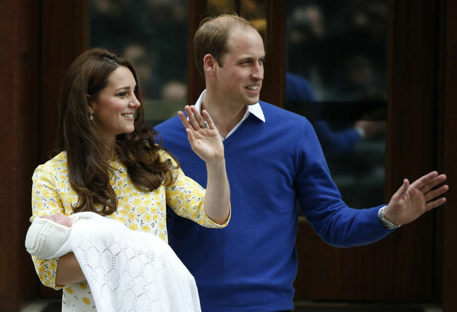 Britain's Prince William, right, and Kate, Duchess of Cambridge, pose for the media with their newborn daughter outside St. Mary's Hospital's exclusive Lindo Wing, London, Saturday, May 2, 2015. The Duchess gave birth to the Princess on Saturday morning. (AP Photo/Alastair Grant) Photo: Alastair Grant