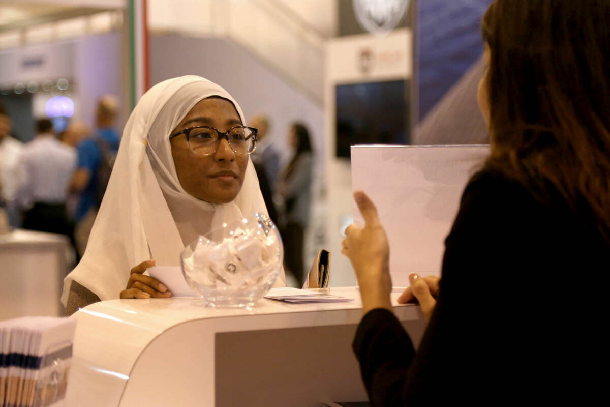 Rownak Rahman, 22, left, of Katy, Texas, shown with Sabrina Sierra, of McDermott, looks for employment at the McDermott Production Systems career booth in the Offshore Technology Conference at the NRG Center Tuesday, May 5, 2015, in Houston, Texas. Rownak, a petroleum engineer graduate from the University of Texas in December 2014, had a contract with Prince Energy up until two weeks after her graduation. Prince rescinded the contract with the down turn in the oil and gas industry. ( Gary Coronado / Houston Chronicle )