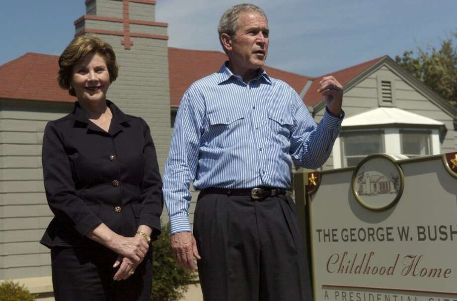 President George and Laura Bush talk about walking through his childhood home, at 1412 West Ohio, after they toured the home restored to it's 1950's era Saturday afternoon following the Bush's attendance at a Republican funraiser. Photo by Tim Fischer 10\4\08 Photo: Midland