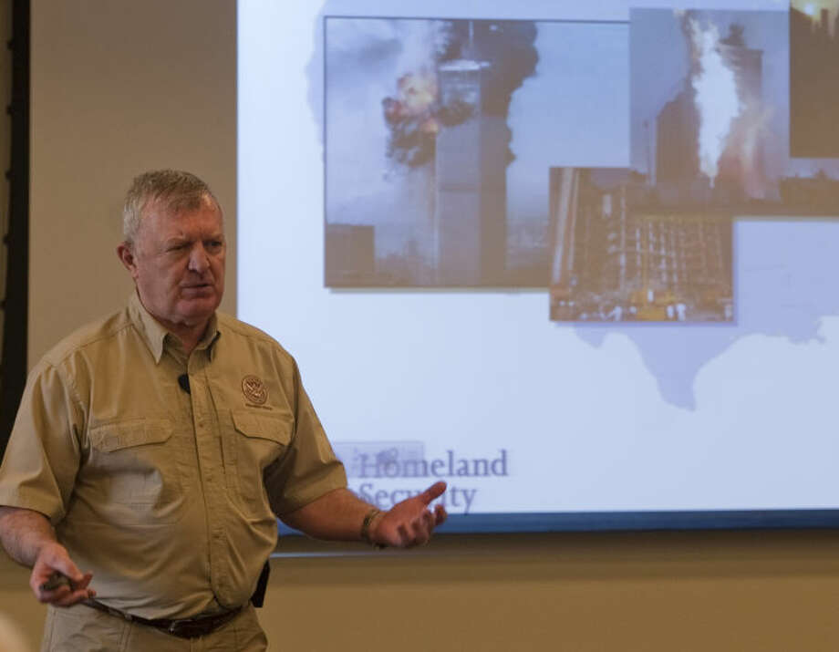 Buck Hamilton, retired USMC, speaks on security Thursday at the Petroleum Museum Brown Bag lunch series. Tim Fischer\Reporter-Telegram Photo: Tim Fischer