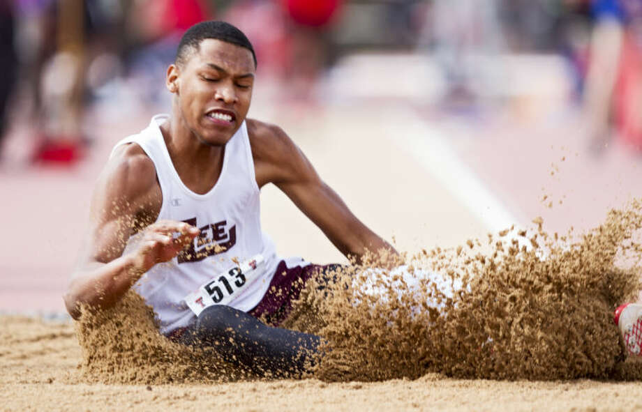 "Midland Lee's Ian Johnson lands in the sand on the long jump during the UIL Regional Track and Field Championship on Saturday at R.P. Fuller Track and Field Complex in Lubbock. Johnson didn't automatically qualify for the state meet after finishing third with his 22' 4-3/4"" jump. Photo: Brad Tollefson"