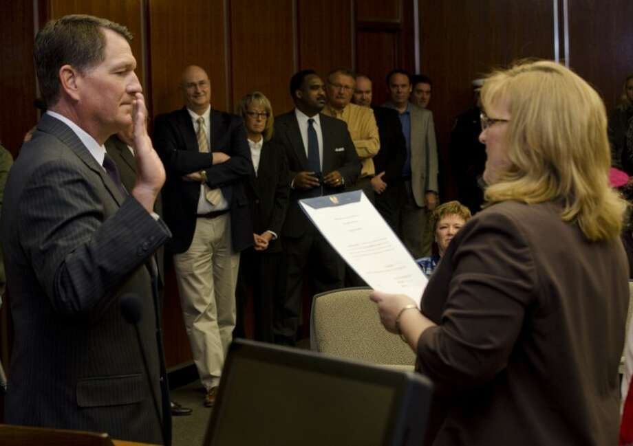 Scott Dufford takes his oath of office Monday as city secretary Amy Turner administers the oath to new and returning council members. Tim Fischer\Reporter-Telegram Photo: Tim Fischer