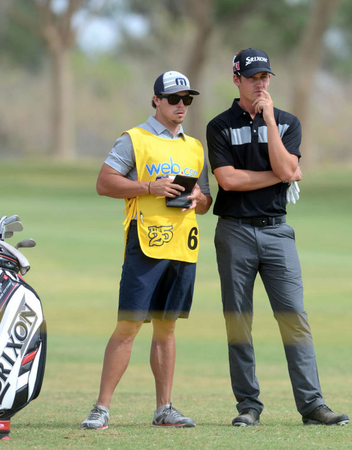 Andrew Putnam discusses a shot with his caddy during the WNB Golf Classic on Saturday at Midland Country Club. James Durbin/Reporter-Telegram