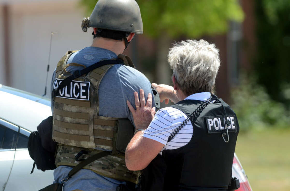 Midland emergency personnel responded to an armed standoff that ended in an apparent murder-suicide Friday. A Midland firefighter was a victim. James Durbin/Reporter-Telegram