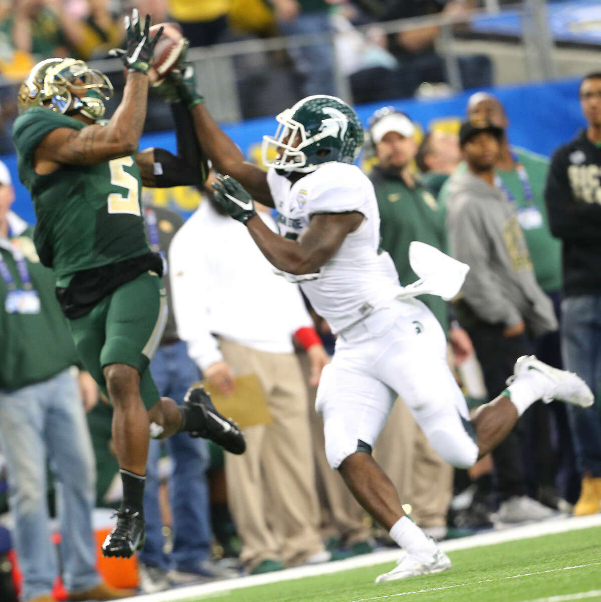 Midland High grad and Baylor wide receiver Antwan Goodley (5) hauls in a pass in the Goodyear Cotton Bowl Classic on Jan. 1 where Goodley's Bears took on the Michigan State Spartans.