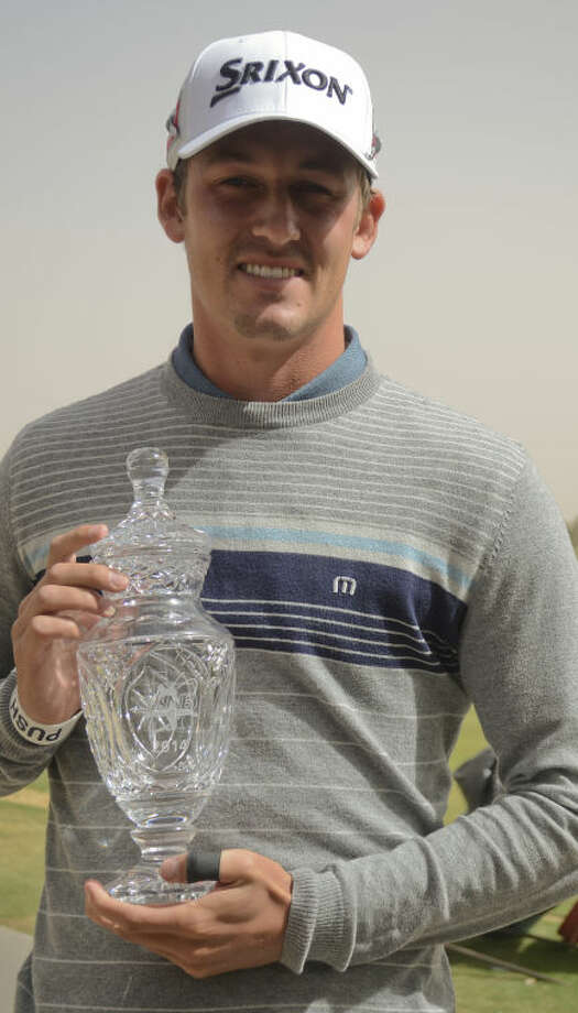 Andrew Putnam holds the trophy for the WNB Golf Classic Sunday at Midland Country Club after a weather/wind delay cancelled the final round. Tim Fischer\Reporter-Telegram Photo: Tim Fischer