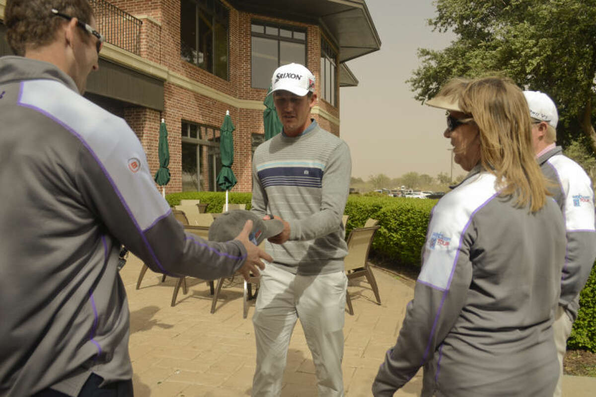 Andrew Putnam signs autographs Sunday after the announcement that the final Sunday round could not be finished for the WNB Golf Classic at Midland Country Club after a weather/wind delay cancelled the final round. Tim Fischer\Reporter-Telegram