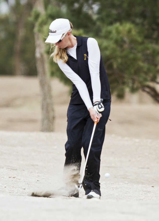 Andrews' Kalli Jennings chips the ball out of a dirt patch during the UIL Girl's 3A Regional Golf Tournament on Thursday at Shadow Hill Golf Course in Lubbock. Jennings finished the day four over par and a 158 during the tournament. Photo: Brad Tollefson
