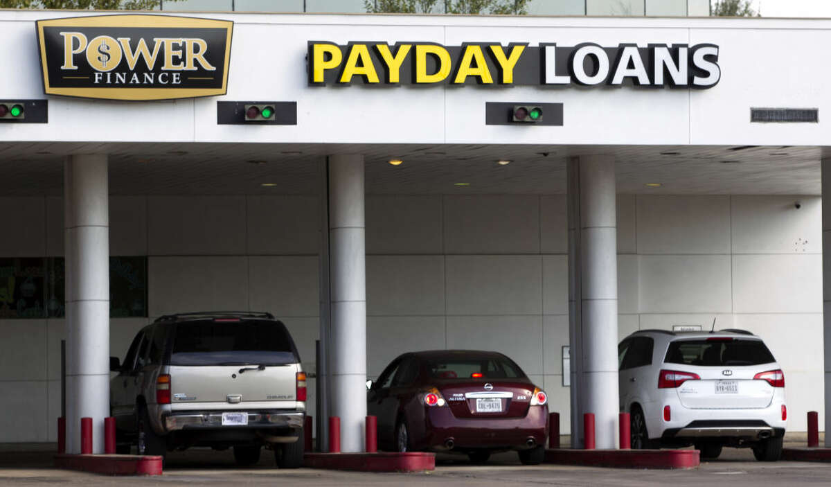 Cars drive up to the Power Finance Payday Loans on Monday, Oct. 20, 2014, in Houston . (J. Patric Schneider / For the Chronicle )