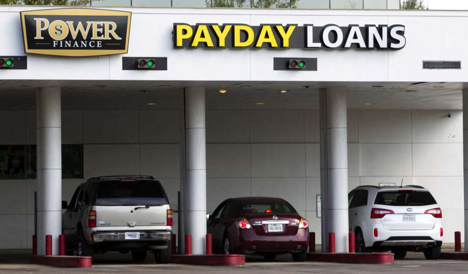 Cars drive up to the Power Finance Payday Loans on Monday, Oct. 20, 2014, in Houston . (J. Patric Schneider / For the Chronicle ) Photo: J. Patric Schneider
