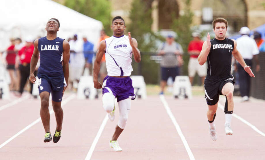 Midland's DeAndre Goodley sprints down the track in the 100M dash during the UIL Regional Track and Field Championship on Saturday at R.P. Fuller Track and Field Complex in Lubbock. Goodley finished third with 10.51 race time. Photo: Brad Tollefson