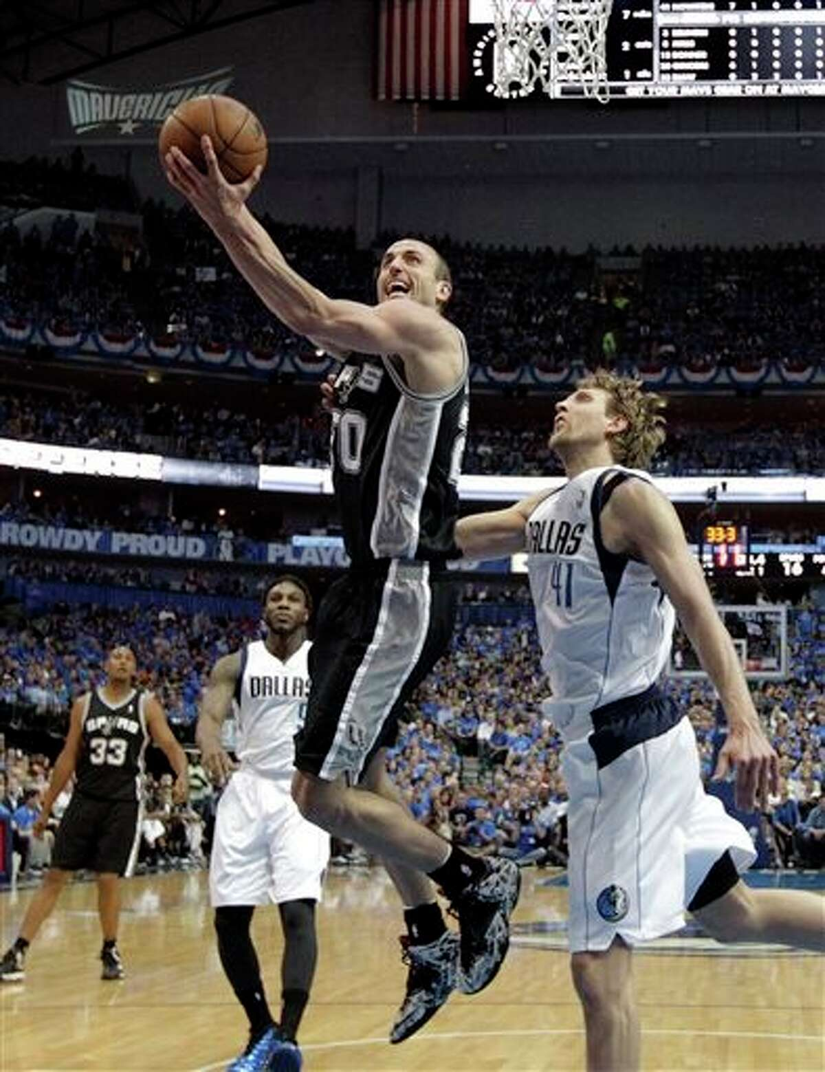 San Antonio Spurs' Manu Ginobili (20) goes up for a shot as Dallas Mavericks' Dirk Nowitzki (41) defends in the first half of Game 4 of an NBA basketball first-round playoff series, Monday, April 28, 2014, in Dallas. (AP Photo/Tony Gutierrez)