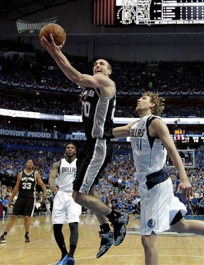 San Antonio Spurs' Manu Ginobili (20) goes up for a shot as Dallas Mavericks' Dirk Nowitzki (41) defends in the first half of Game 4 of an NBA basketball first-round playoff series, Monday, April 28, 2014, in Dallas. (AP Photo/Tony Gutierrez) Photo: Tony Gutierrez / AP