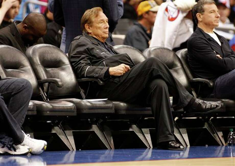 FILE - In this April 4, 2010, file photo, Los Angeles Clippers owner Donald Sterling sits courtside during the NBA basketball game between the New York Knicks and the in Los Angeles. NBA Commissioner Adam Silver Silver announced Tuesday, April 298, 2014, that Sterling has been banned for life by the league, in response to racist comments the league says he made in a recorded conversation.(AP Photo/Danny Moloshok, File) Photo: Danny Moloshok / FR161655 AP
