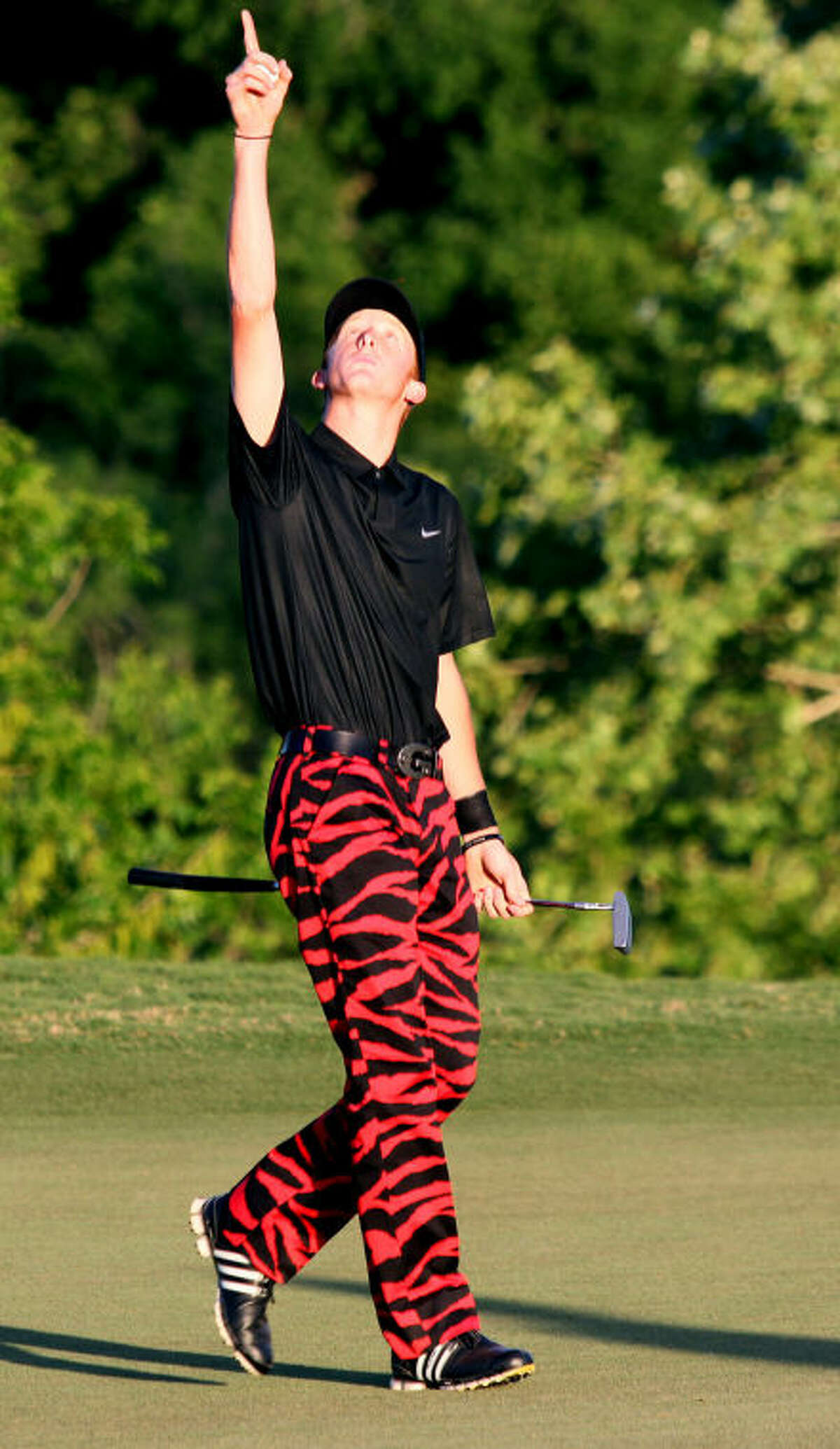 Andrews G.K. Morrison celebrates on the 18th hole during the second and final day of the Class 3A State Golf Championships Tuesday at the Hyatt Resort Lost Pines Golf Course.