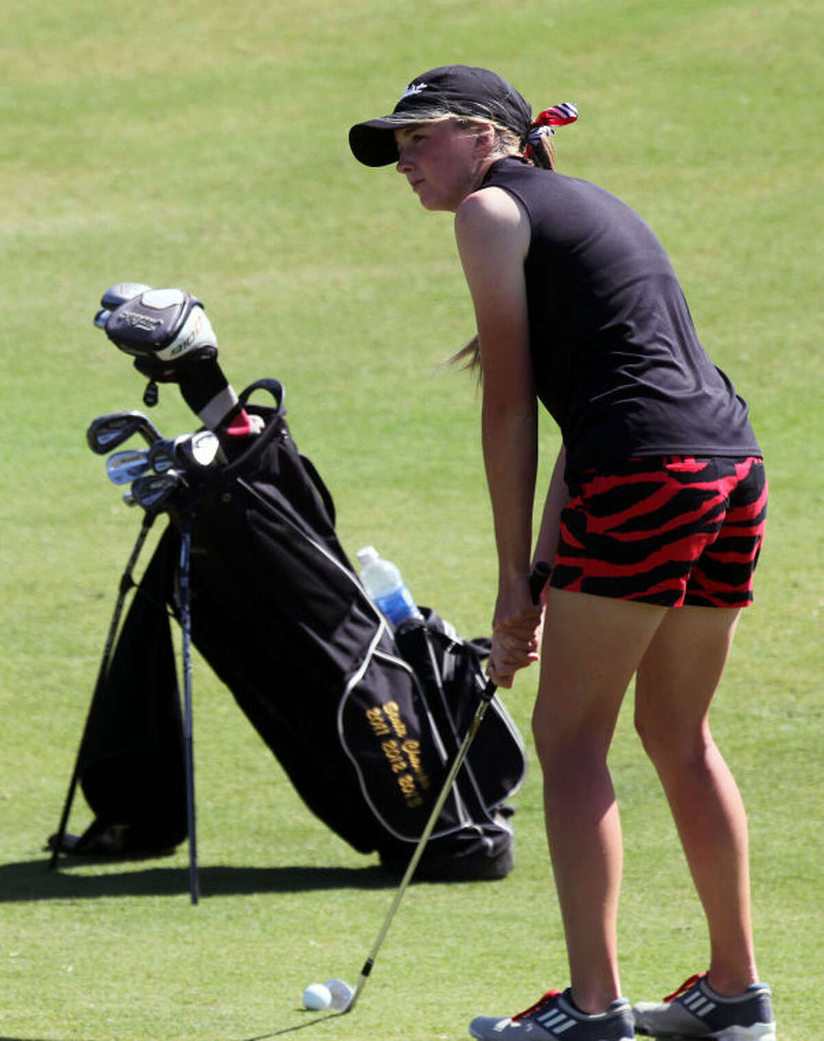 Andrews Sarah Black adjusts her shot towards the hole during the second and final day of the Class 3A State Golf Championships Tuesday at the Hyatt Resort Lost Pines Golf Course.