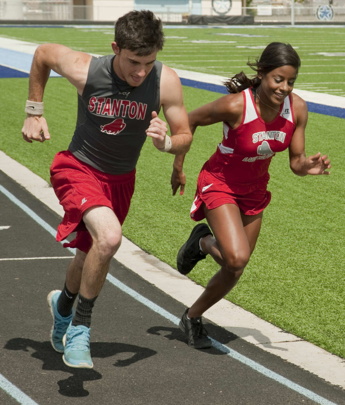 Stanton runners Jonathan Tomlinson and Latriceia Smith practice Wednesday, 5-6-15, after both qualifying for the state meet. Tim Fischer\Reporter-Telegram