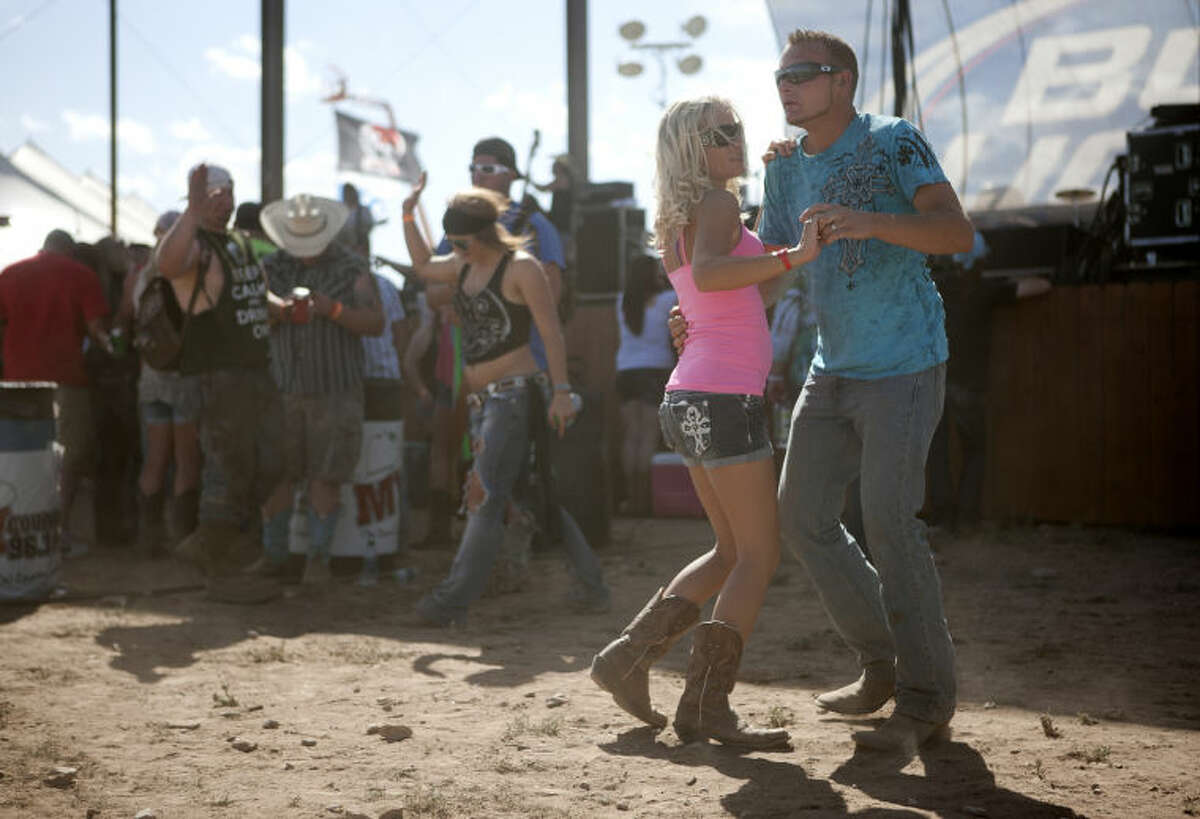Marty and Ginger Richter of Big Spring dance at the Crudefest Music Festival on Friday at Star of Texas Ranch. James Durbin/Reporter-Telegram