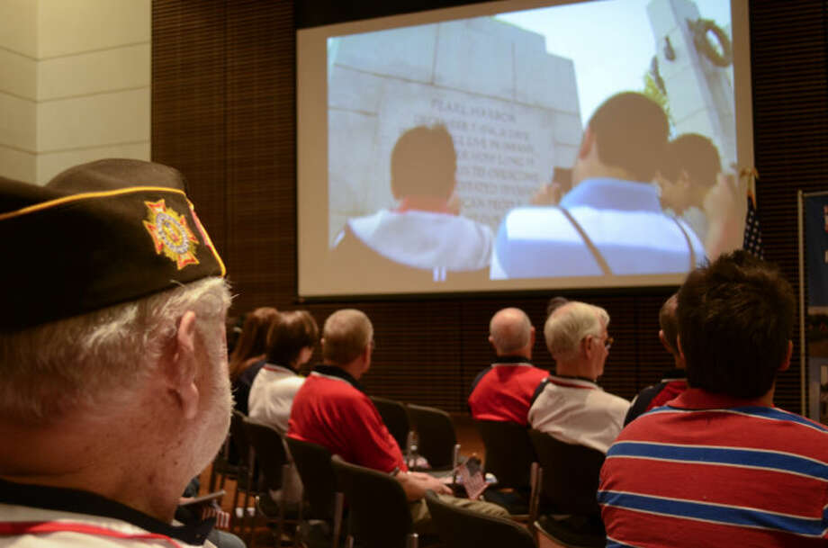 Joe Rickey and others watch a video about the WWII Memorial in Washington DC during a press conference Tuesday on the Honor Flight for Permina Basin WWII veterans/ Tim Fischer\Reporter-Telegram Photo: Tim Fischer